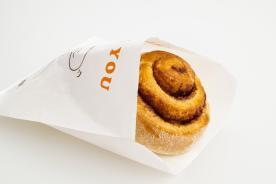 Filled pastry in a greaseproof paper bag