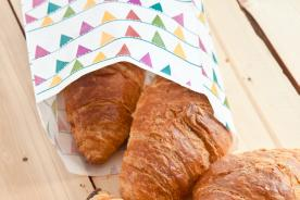 Sweet pastries in a greaseproof paper bag