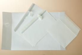 Envelopes and pockets with a silicone paper strip